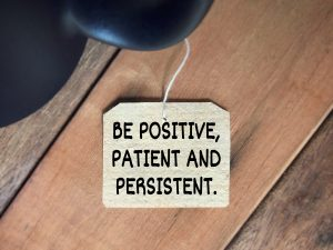 Be positive, patient and persistent. Blurred styled background.